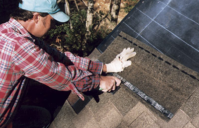 installing shingles on roof