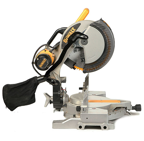 Dw706 compound miter saw review fine homebuilding with the motor positioned toward the rear of the machine and the blade arbor being driven with a multi v belt the dw706 achieves its full double bevel keyboard keysfo Choice Image