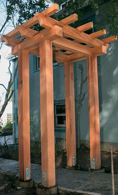 Pergolas are designed to support climbing plants, but unlike arbors,  pergolas have posts supporting a rooflike structure. - What's The Difference: Trellis, Arbor, And Pergola - Fine Homebuilding