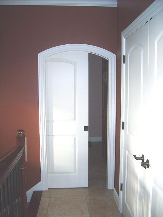 Door in Arched Pocket & Cutting Corners: Arches and Pocket Doors - Fine Homebuilding