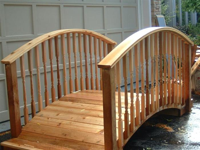 I made this cedar arched garden bridge in my drive because I had no where else that could handle the size. The railing is made with laminations that spent ...