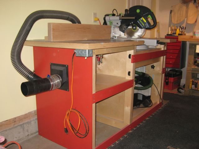 Miter saw challenge fine homebuilding photo shows router table to left and miter saw to right router table has door to provide chamber to collect the chips also on left is hookup for 4 greentooth Choice Image