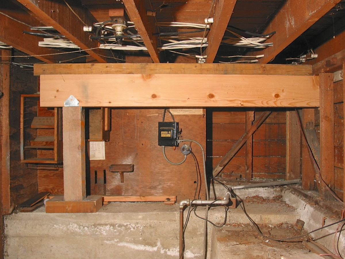 Shoring Up A Floor : Temporary support beams for sill and foundation work