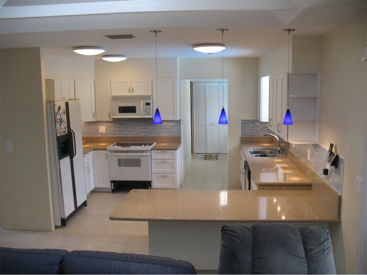 Short format base cabinets and accessible storage make kitchen work ...