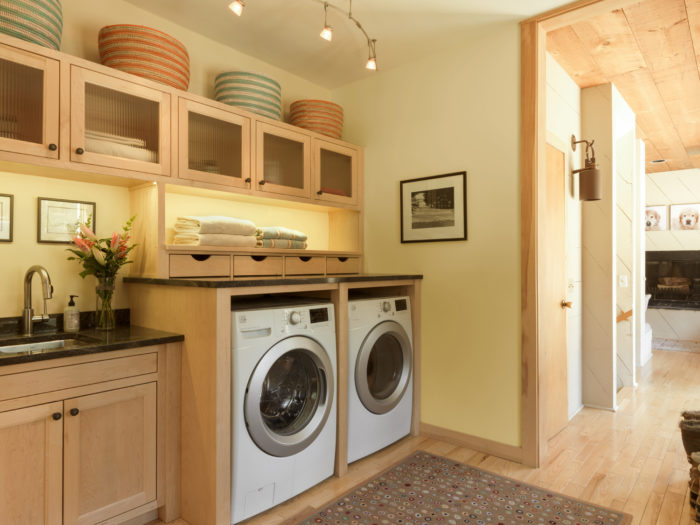 Bon Sharing Space With A Mudroom, This Small Laundry Area Provides Ample  Storage With Custom Built Maple Cabinetry In A Natural Finish. The Upper  Cabinet Doors ...