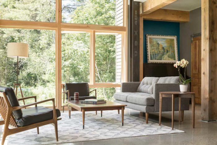 Invigorating sunlight and serene moonlight dance through broad windows, inviting the landscape inside.