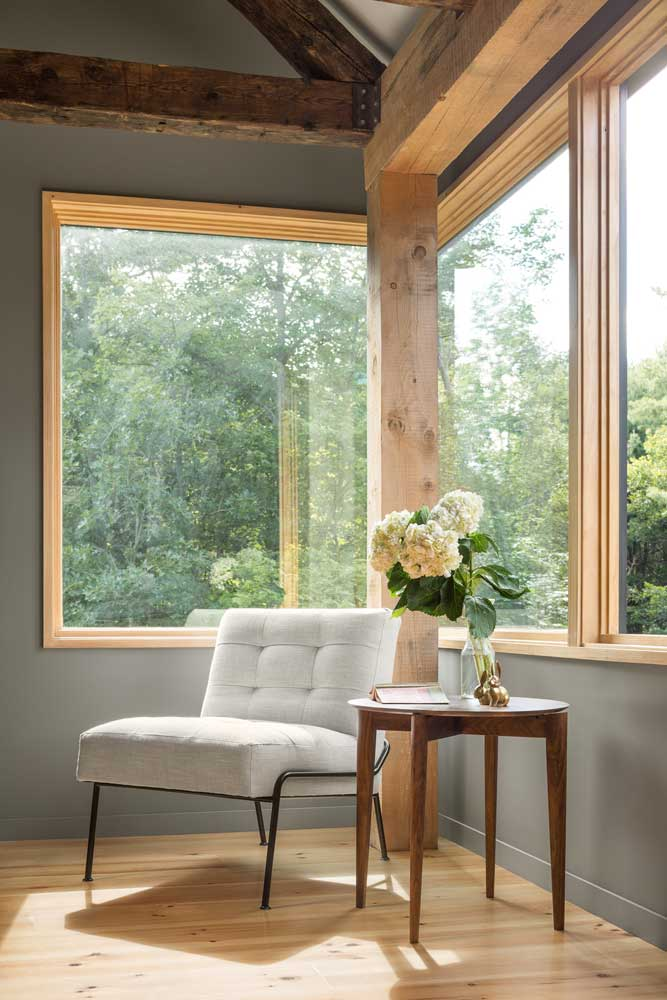 Integrity Wood-Ultrex windows give this home a sleek facade with black fiberglass exteriors and accent the rustic decor with warm, pine interiors.