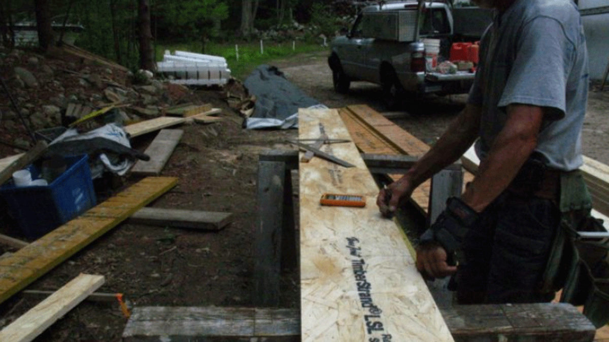 person building stair stringers