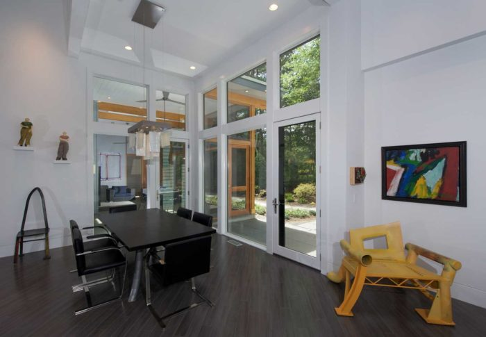 Integrity inswing French doors open this creative sanctuary to the inspiring surroundings.