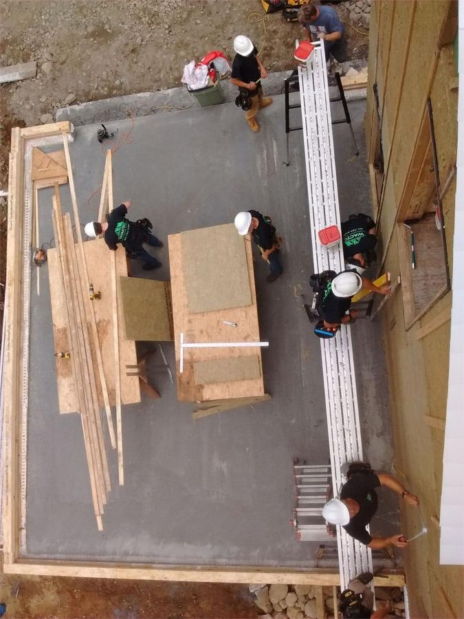 installing Roxul IS 2-in. insulation on garage wall
