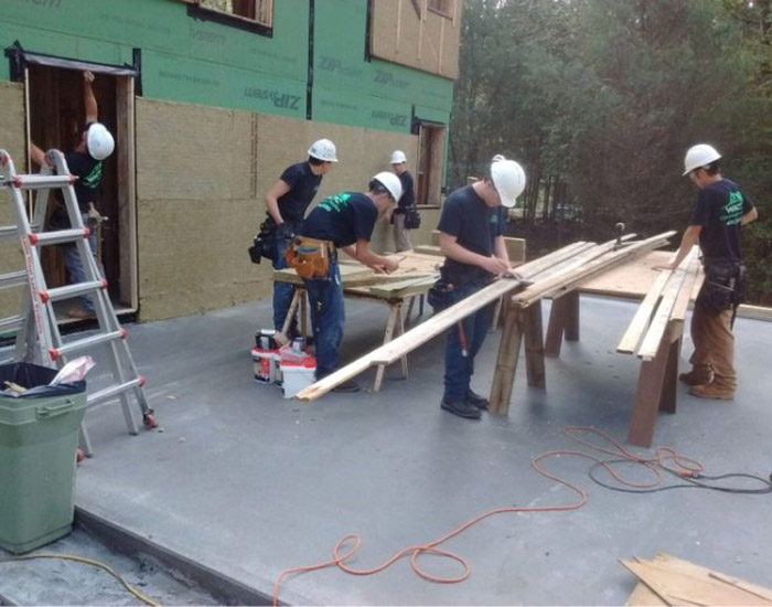 students working on construction site