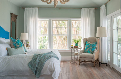 Falling asleep to the rustling trees and crashing waves is made possible by Integrity's windows and doors. The large picturesque windows and sliding door flood the bedroom with calming morning light and a salty sea breeze for a peaceful indoor retreat.