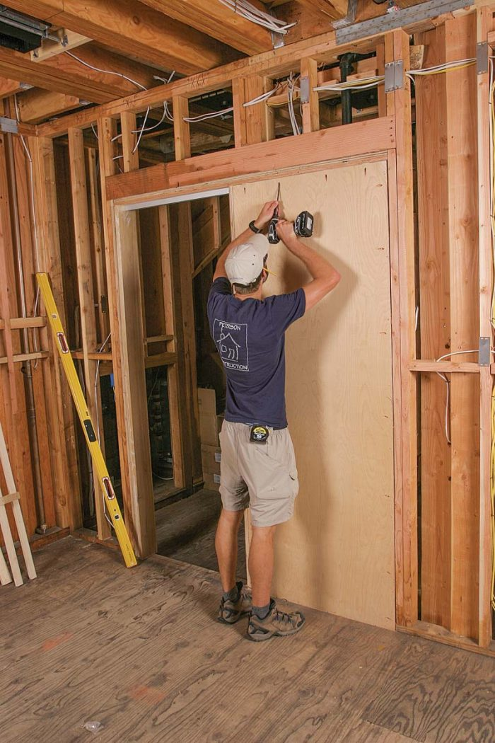 Close the pocket. With the track in place, fasten the second side of the pocket to the subfloor and surrounding framing with pocket screws.