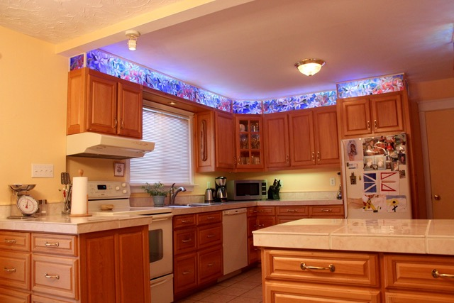 Kitchen with Above-Cabinet LED Lights, Corner Drawers ...