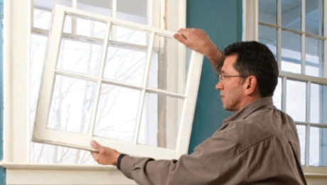 person installing a window
