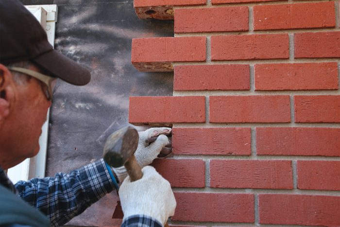 chisel where necessary, tapping lightly to protect the brick veneer