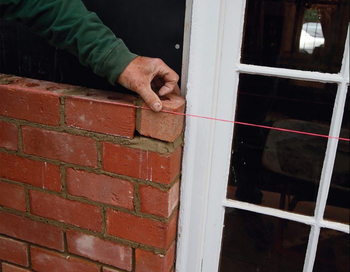 placing a small brick to end the line