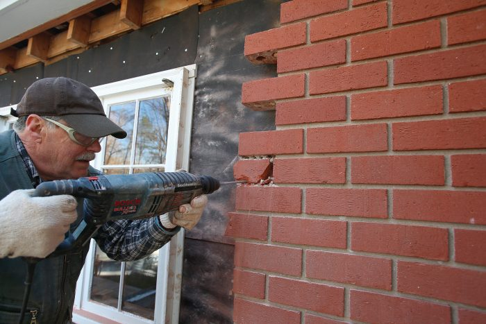 break the brick by drilling holes in the mortar