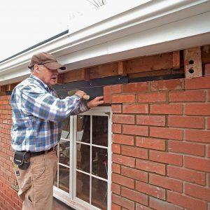 hammering in the brick with no mortar between