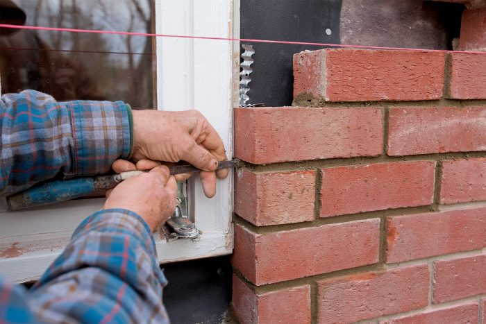 use a tuck to fit where the brick returns to the window