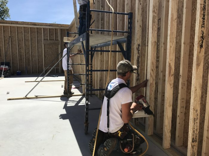 John nails the interior wall of TimberStrand 2x4s in place.