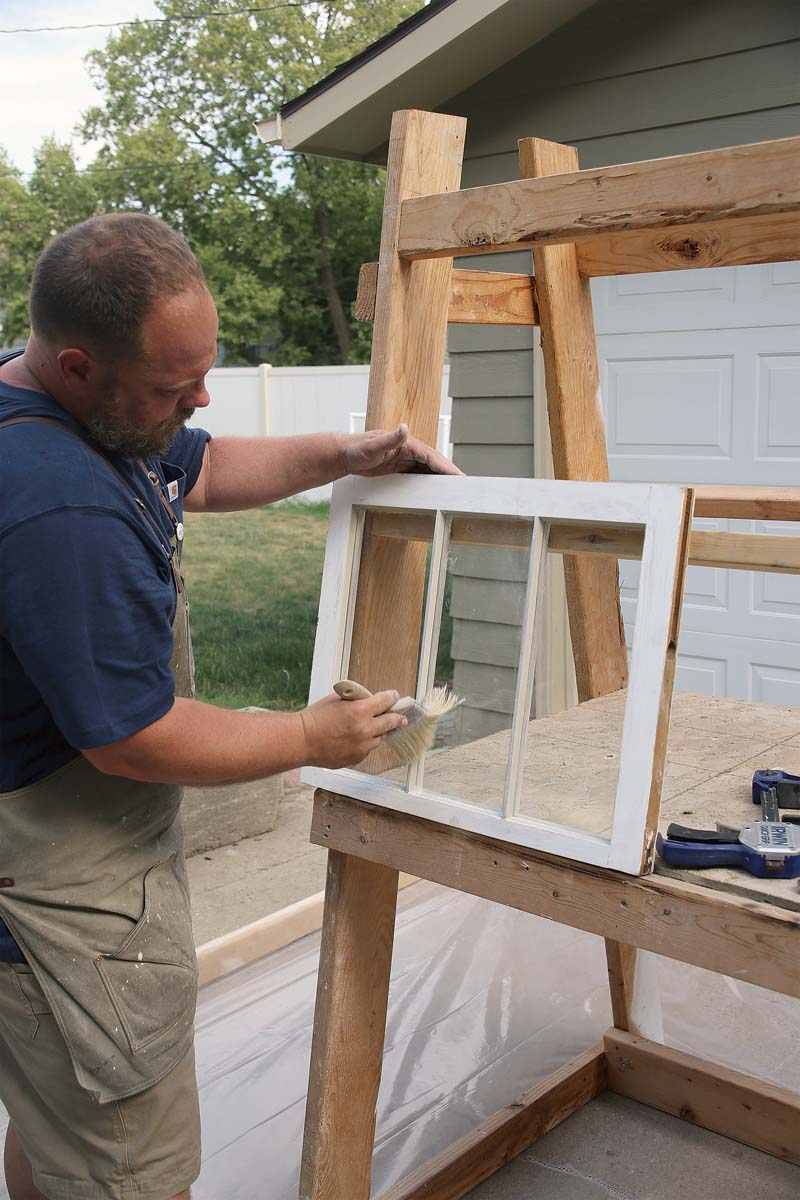 Brush the glass with chalk to remove any oil residue from the glazing putty.
