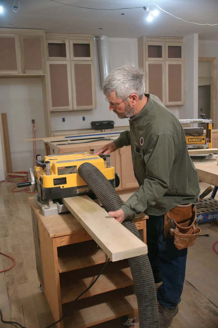 Run all of the rough-cut stiles and rails through the planer, taking 1⁄16 in. off of each face.