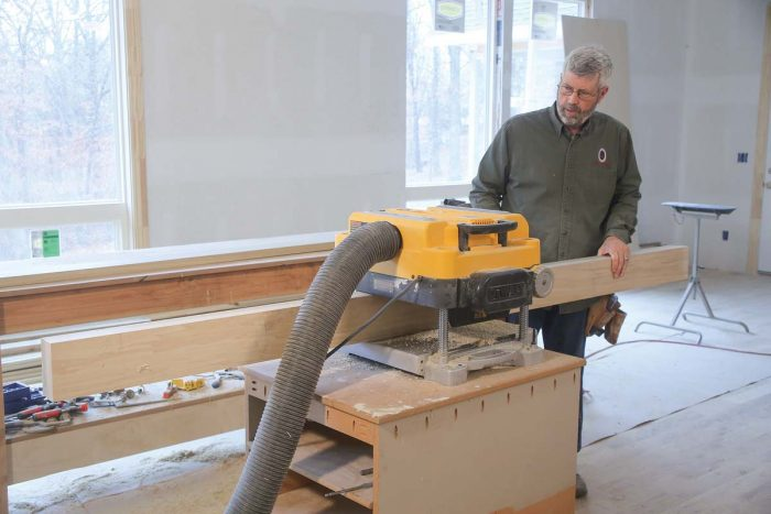 On edge. After ripping all of the stiles and rails about 1⁄8 in. wider than their final dimension on the tablesaw, send them through the planer to get them to their final width.