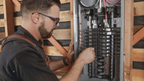 person working on subpanel
