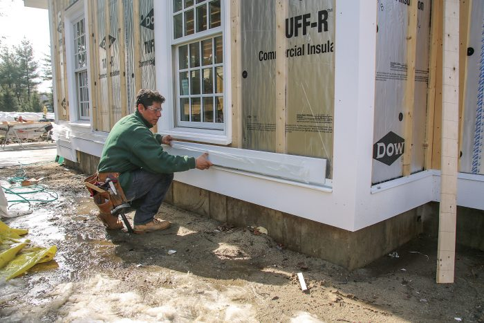 Set the first course of siding atop the same 1⁄4-in.-thick shims to create a drainage space between it and the water table below