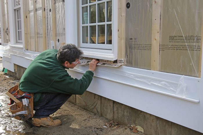 To prevent wind-driven rain from getting under windows, lap the bottom of the windowsill