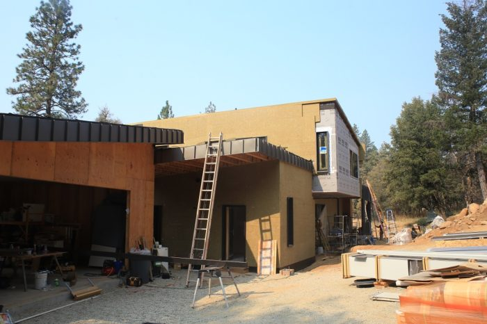 All of the conditioned space has exterior insulation. The second layer on the walls flushes out with the windows.