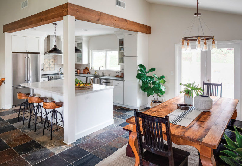 decorative wood beams around the top of a corner kitchen