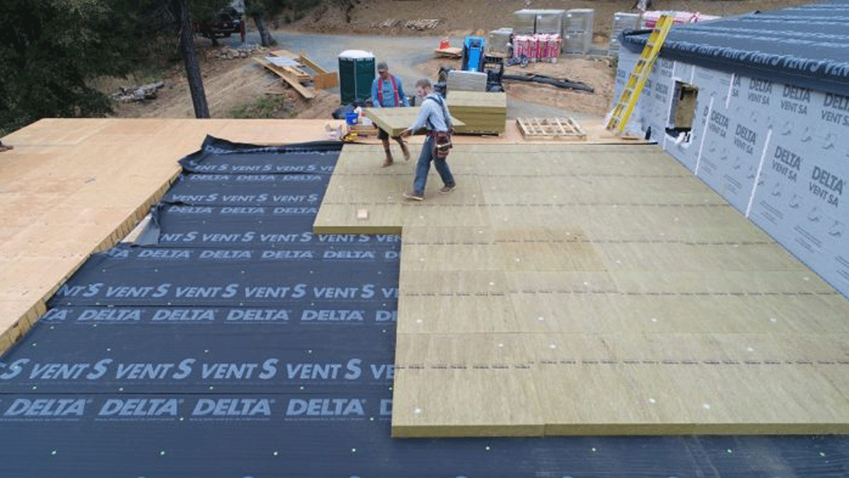 TopRock DD is a dense, rigid Rockwool panel that doesn't compress underfoot. It's intended for low slope roofs like this.