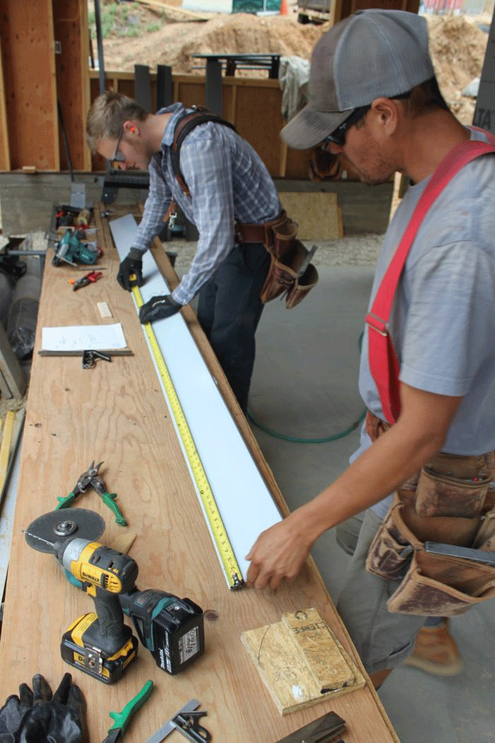 Fabricating some flashing for the windows to accommodate 4 in. of exterior insulation.