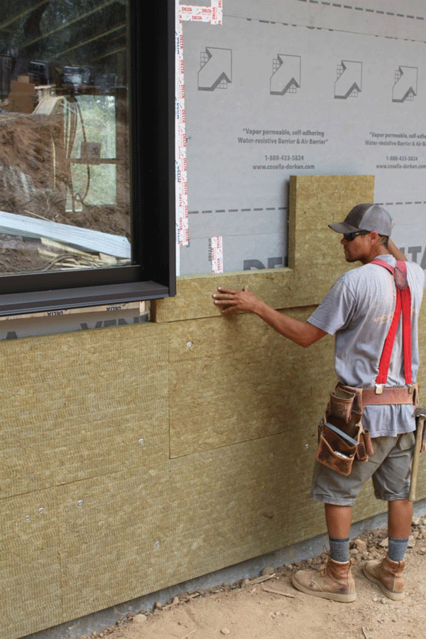 The rigid board cuts nicely to fit around windows and doors.