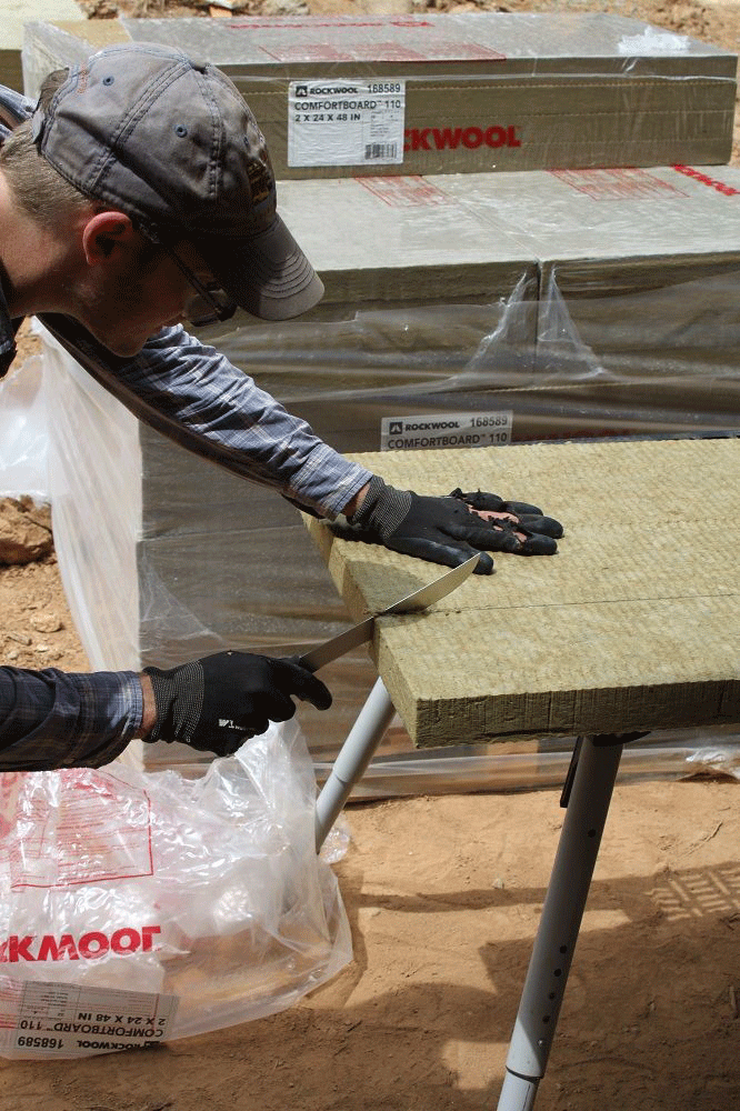 The Rockwool was cut with bread knifes and handsaws depending on the carpenter's preference.