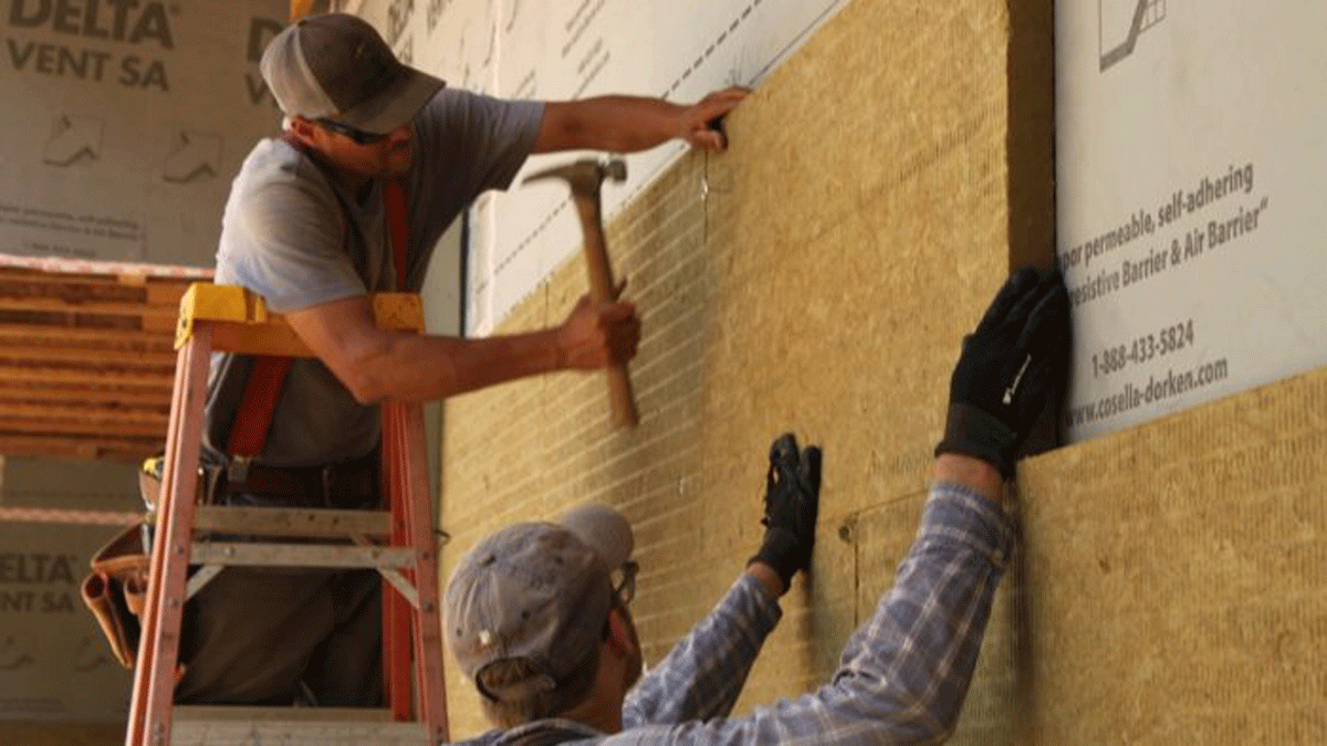 A few washer nails hold the ComfortBoard in place. The siding will also secure it. The walls are covered in two layers of 2-in.-thick Rockwool.