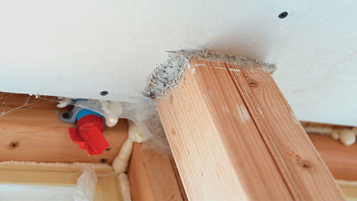 Builds up bit by bit. Aided by the pressure from a blower door, the sealant slowly accumulates at gaps and cracks as it travels with the escaping air. You can see the buildup around electrical boxes and any gaps in the drywall.