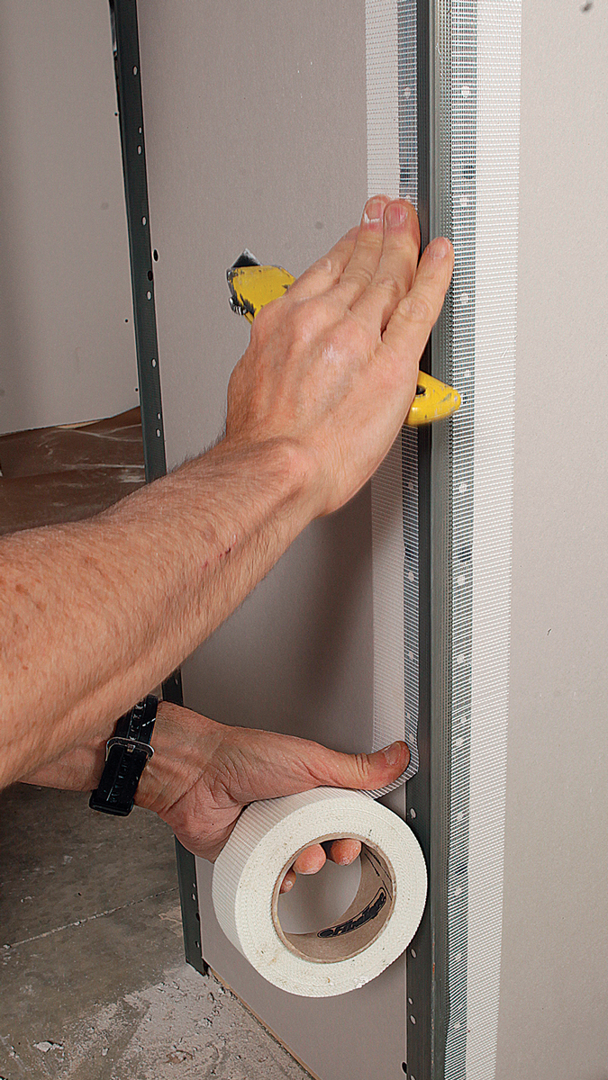 Avoid cracks. Apply self-adhering mesh tape over the flanges and onto the drywall to help prevent cracking along the edges.