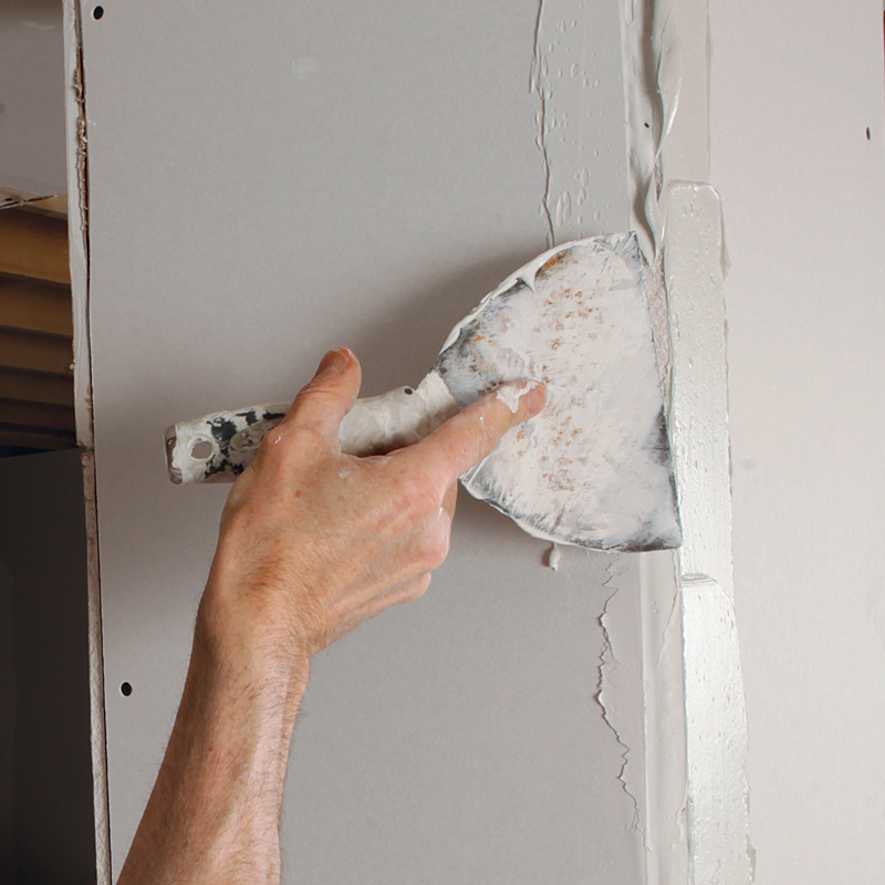 Mud both sides. Use a 4-in. to 6-in. taping knife to apply an even coat of joint compound to both sides of the corner.