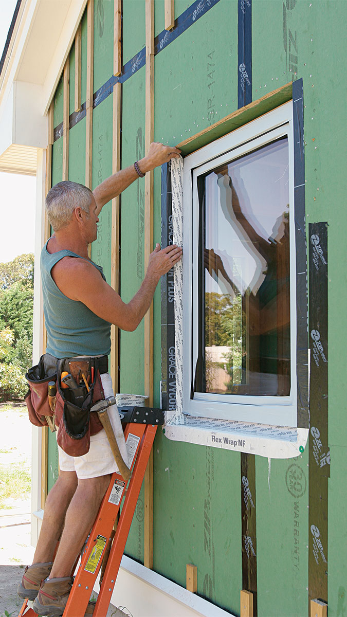 Person working on flashing a window