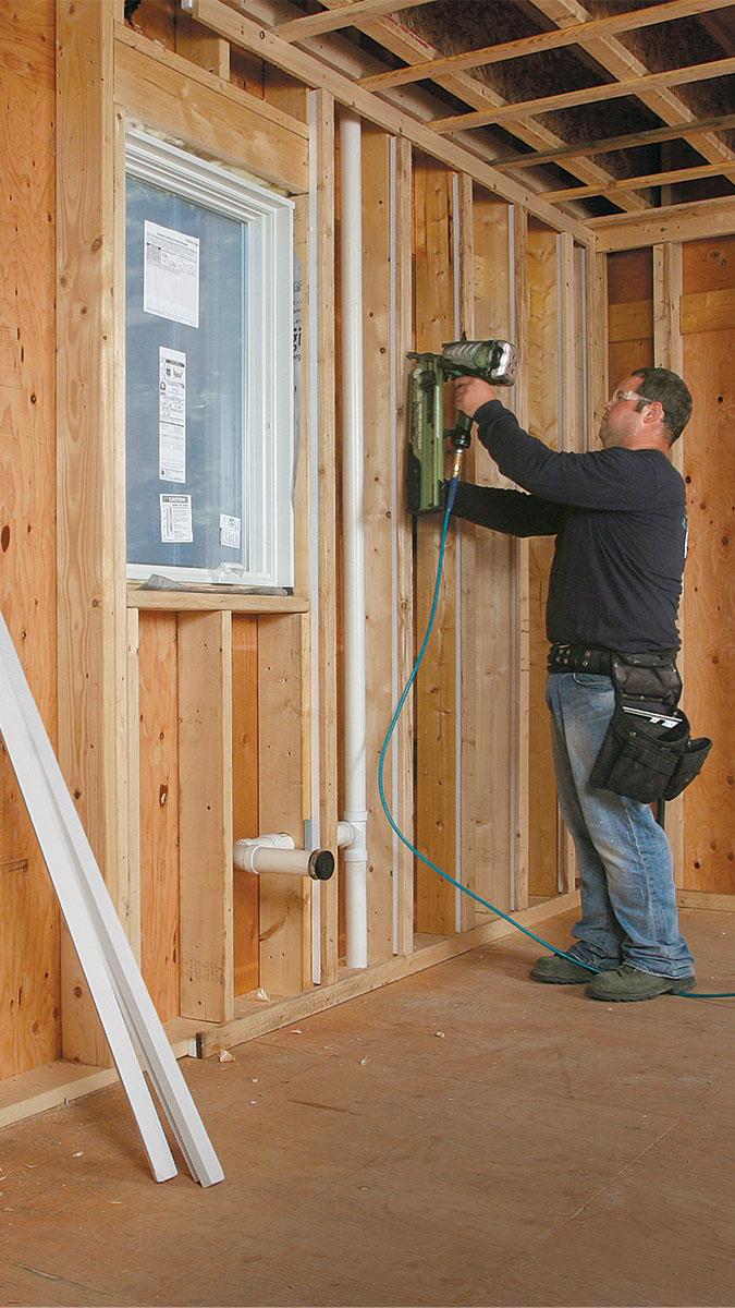 man drilling a wall