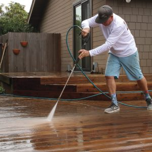 Finish with a light rinse. After scrubbing, rinse the deck surface with a pressure washer equipped with a 40° tip. The wide nozzle won't damage wood fibers like more aggressive tips. Start at the house and work toward the edge, pushing the dirt as you move.