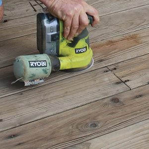 Sand rough spots. Sanding the whole deck is unnecessary, but split or checked boards should be sanded to prevent painful splinters. Ensure fasteners are driven below the deck surface before sanding.