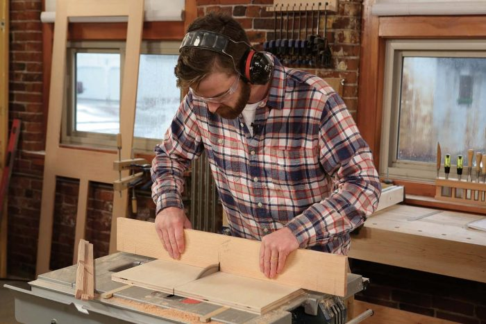 Notching makes mortises. Make a series of nibble cuts to create notches in the rails and stiles of the middle layer that will accept the muntin tenons.