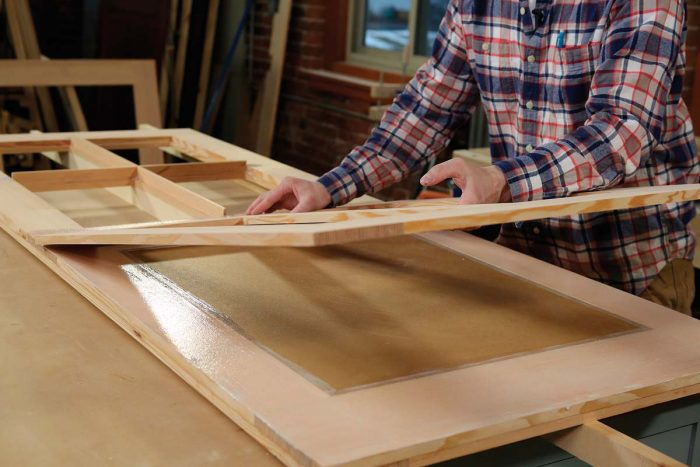 Use a mini paint roller to apply a thin coat onto both mating surfaces, overlapping the edges of the MDO panel.