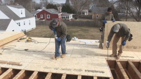 contractors working on subfloor installation