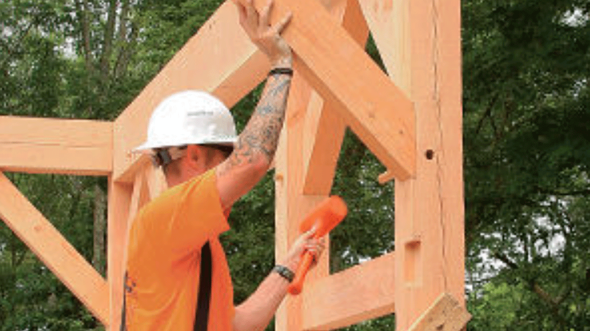 Worker working on timber frame home