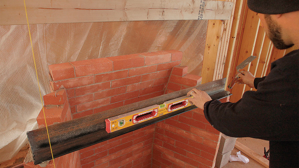Add the lintel and damper when building a modern Rumford fireplace